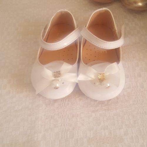 Un chaussure bébé poiture 20